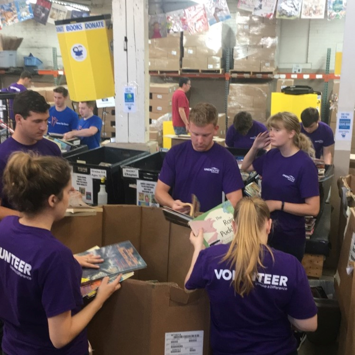 A group of interns volunteering at a book drive